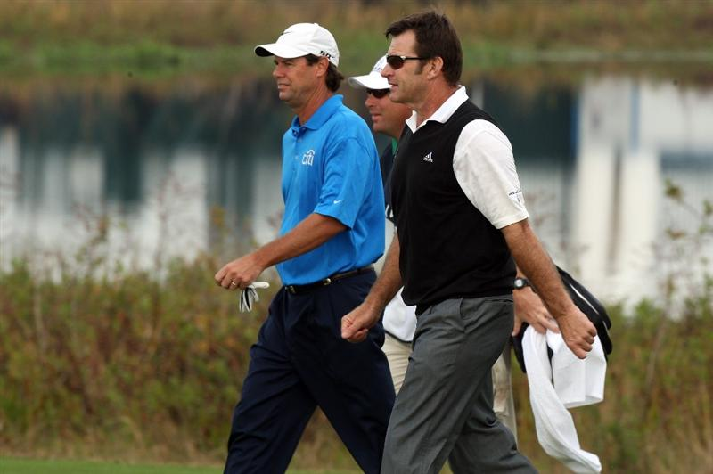 CHAMPIONS GATE, FL - DECEMBER 06: Nick Faldo of England and Paul Azinger of the USA the 2008 Ryder Cup Captains walk from the 1st tee during the first round of the Del Webb Father/Son Challenge on the International Course at Champions Gate Golf Club on December 6, 2008 in Champions Gate, Florida.  (Photo by David Cannon/Getty Images)