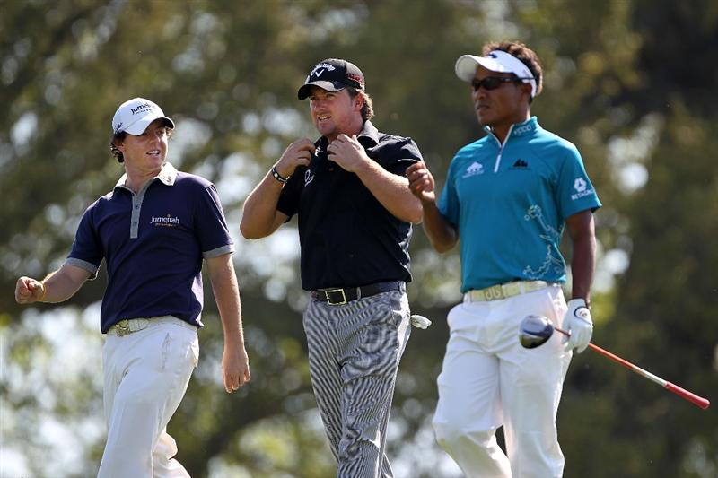 AUGUSTA, GA - APRIL 06:  Rory McIlroy (L) and Graeme McDowell (C) of Northern Ireland and Thongchai Jaidee of Thailand walk off a tee box during a practice round prior to the 2010 Masters Tournament at Augusta National Golf Club on April 6, 2010 in Augusta, Georgia.  (Photo by Jamie Squire/Getty Images)