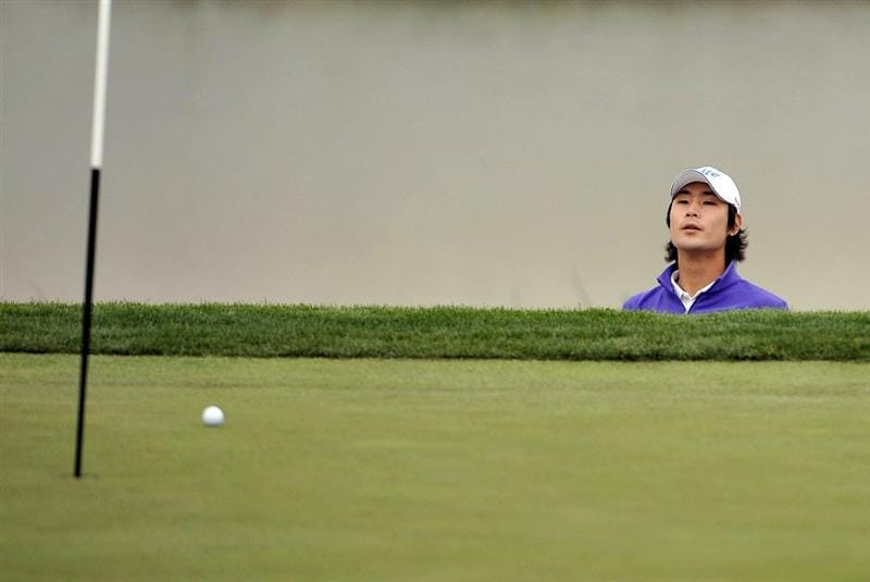SUZHOU, CHINA - APRIL 15:  Kim Dae-hyun of South Korea looks at his ball after chips into the 16th green during the Round One of the Volvo China Open on April 15, 2010 in Suzhou, China.  (Photo by Victor Fraile/Getty Images)