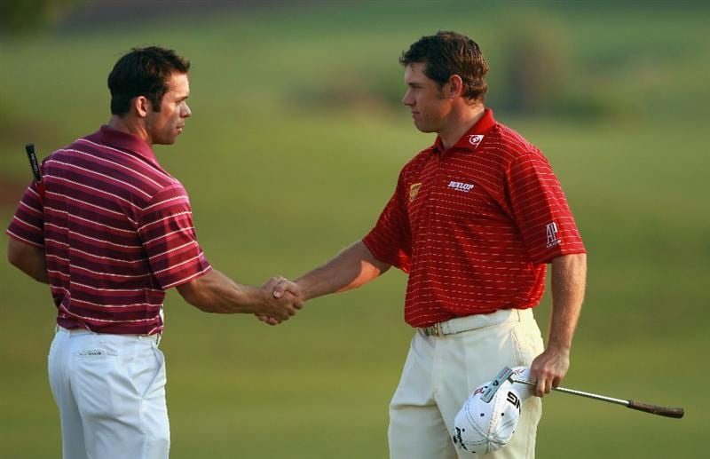 DUBAI, UNITED ARAB EMIRATES - NOVEMBER 27:  Paul Casey of England (left) shakes hands with Lee Westwood of England on the 18th green during the third round of the Dubai World Championship on the Earth Course, Jumeirah Golf Estates on November 27, 2010 in Dubai, United Arab Emirates.  (Photo by Andrew Redington/Getty Images)