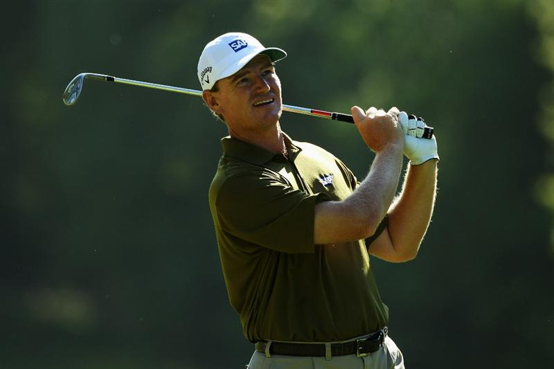 VIRGINIA WATER, ENGLAND - MAY 22:  Ernie Els of South Africa plays his second shot on the 16th hole during the third round of the BMW PGA Championship on the West Course at Wentworth on May 22, 2010 in Virginia Water, England.  (Photo by Warren Little/Getty Images)