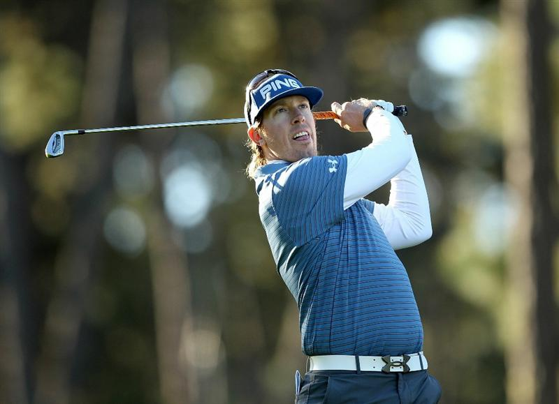 PEBBLE BEACH, CA - FEBRUARY 10:  Hunter Mahan tees off on the 13th hole at the Spyglass Hill Golf Course during Round One of the AT&T Pebble Beach National Pro-Am on February 10, 2011 in Pebble Beach, California.  (Photo by Ezra Shaw/Getty Images)