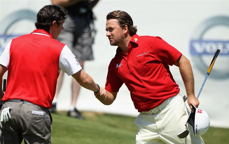 CASARES, SPAIN - MAY 21:  Victor Graeme McDowell of Northern Ireland is congratulated by countryman Rory McIlroy after winning his last 16 match of the Volvo World Match Play Championships at Finca Cortesin on May 20, 2011 in Casares, Spain.  (Photo by Warren Little/Getty Images)