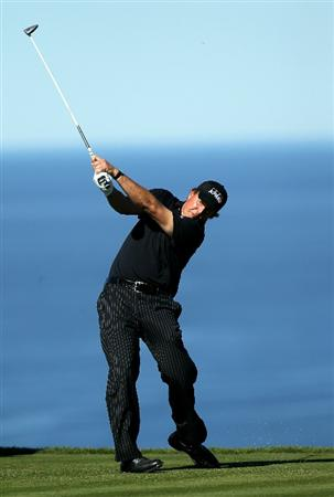 LA JOLLA, CA - JANUARY 27:  Phil Mickelson hits his tee shot on the fifth hole during round one of the Farmers Insurance Open at Torrey Pines North Course on January 27, 2011 in La Jolla, California.  (Photo by Stephen Dunn/Getty Images)