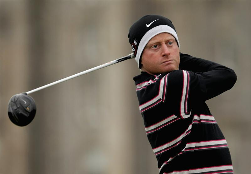 ST ANDREWS, SCOTLAND - OCTOBER 10:  Simon Dyson of England drives off the second tee during the final round of The Alfred Dunhill Links Championship at The Old Course on October 10, 2010 in St Andrews, Scotland.  (Photo by Andrew Redington/Getty Images).