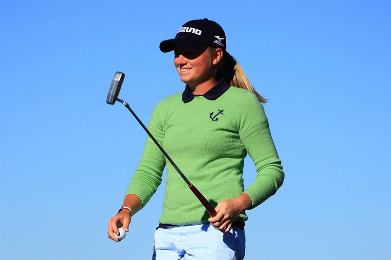 DAYTONA BEACH, FL - DECEMBER 07:  Stacy Lewis smiles as she walks off the 18th green after her three-stroke victory at the LPGA Qualifying School at LPGA International on December 7, 2008 in Daytona Beach, Florida.  (Photo by Scott Halleran/Getty Images)