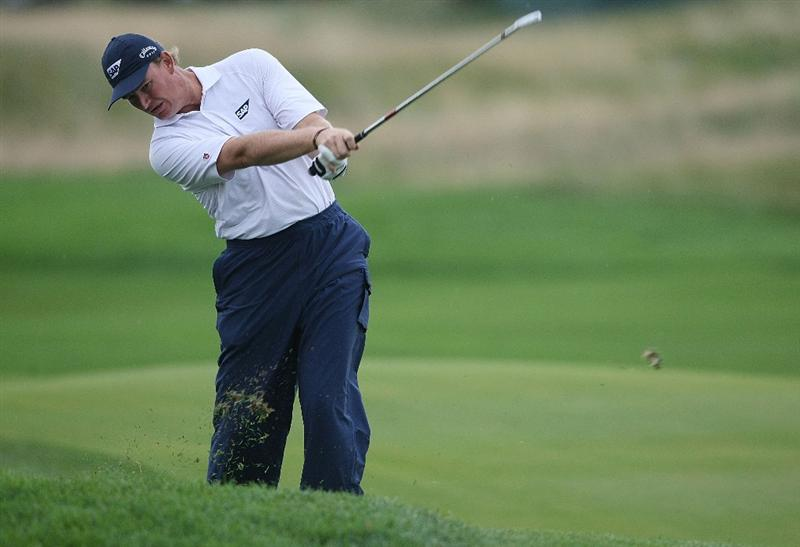 JERSEY CITY, NJ - AUGUST 28:  Ernie Els of South Africa hits from the rough on the 12th hole during round two of The Barclays on August 28, 2009 at Liberty National in Jersey City, New Jersey.  (Photo by Nick Laham/Getty Images)