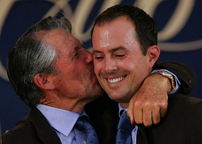 International Team Captain Gary Player kisses Mike Weir of Canada during the opening ceremonies prior to the start of The Presidents Cup at The Royal Montreal Golf Club on September 26, 2007 in Montreal, Quebec, Canada. PGA TOUR - 2007 The Presidents Cup - September 26, 2007Photo by S.Greenwood/WireImage.com
