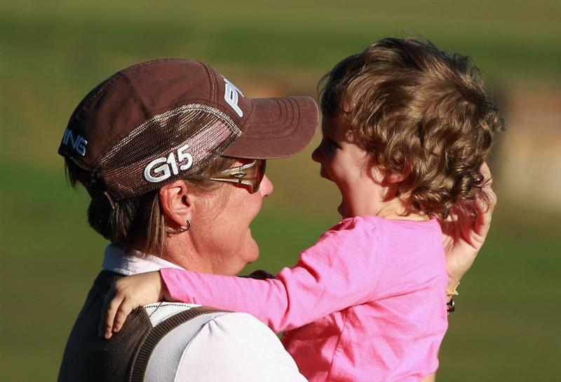 ORLANDO, FL - DECEMBER 05:  Maria Hjorth of Sweden celebrates with her daughter Emily on the 18th green after winning the LPGA Tour Championship at the Grand Cypress Resort on December 5, 2010 in Orlando, Florida.  (Photo by Scott Halleran/Getty Images)