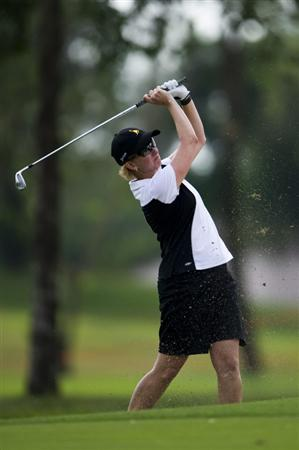 CHON BURI, THAILAND - FEBRUARY 21:  Karrie Webb of Australia plays an approach shot on the 14th hole during the final round of the Honda PTT LPGA Thailand at Siam Country Club on February 21, 2010 in Chon Buri, Thailand.  (Photo by Victor Fraile/Getty Images)