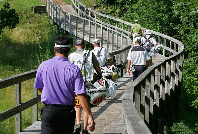 SILVIS, IL - JULY 11:  Players cross the bridge on the 15th hole during the continuation of the second round of the John Deere Classic at TPC Deere Run held on July 11, 2009 in Silvis, Illinois.  (Photo by Michael Cohen/Getty Images)
