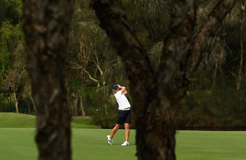 GOLD COAST, AUSTRALIA - MARCH 07:  Karrie Webb of Australia plays a fairway wood on the 15th hole during round four of the 2010 ANZ Ladies Masters at Royal Pines Resort on March 7, 2010 in Gold Coast, Australia.  (Photo by Ryan Pierse/Getty Images)