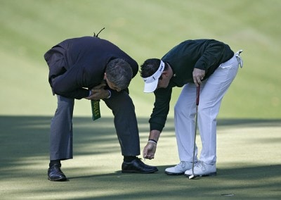 Rory Sabbatini gets a ruling from  a rules official during the final round of the 2007 Masters at the Augusta National Golf Club in Augusta,  Georgia, on April 8, 2007. Photo by Hunter Martin/WireImage.com