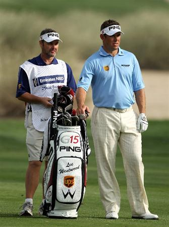 DUBAI, UNITED ARAB EMIRATES - FEBRUARY 05:  Lee Westwood of England waits with his caddie Billy Foster on the 16th hole during the second round of the Omega Dubai Desert Classic on February 5, 2010 in Dubai, United Arab Emirates.  (Photo by Andrew Redington/Getty Images)