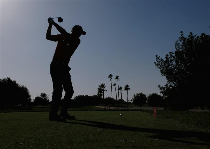 DOHA, QATAR - FEBRUARY 04:  Markus Brier of Austria hits his tee-shot on the fifth hole during the second round of the Commercialbank Qatar Masters held at Doha Golf Club on February 4, 2011 in Doha, Qatar.  (Photo by Andrew Redington/Getty Images)