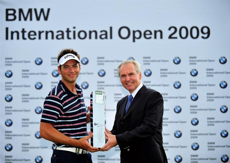 MUNICH, GERMANY - JUNE 28:  Nick Dougherty of England is presented with the winners trophy by Doctor Friedrich Eichiner, Member of the board of the BMW group after the final round of The BMW International Open Golf at The Munich North Eichenried Golf Club on June 28, 2009, in Munich, Germany.  (Photo by Stuart Franklin/Getty Images)