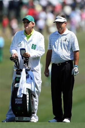 AUGUSTA, GA - APRIL 12:  Kenny Perry and his caddie Fred Sanders look at the second shot on the first hole during the final round of the 2009 Masters Tournament at Augusta National Golf Club on April 12, 2009 in Augusta, Georgia.  (Photo by Andrew Redington/Getty Images)