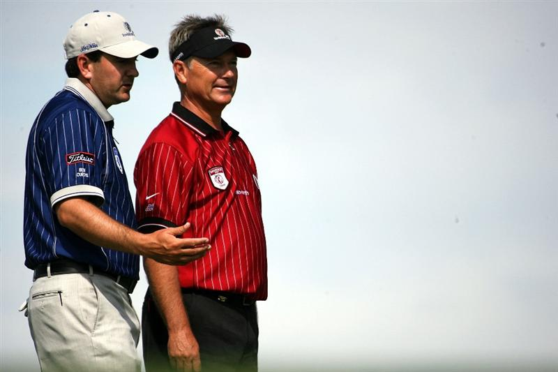 ORLANDO, FL - MARCH 17:  Ben Curtis (L) and John Cook chat on the first hole at the Tavistock Cup on March 17, 2009 at Lake Nona Country Club in Orlando, Florida.  (Photo by Marc Serota/Getty Images)