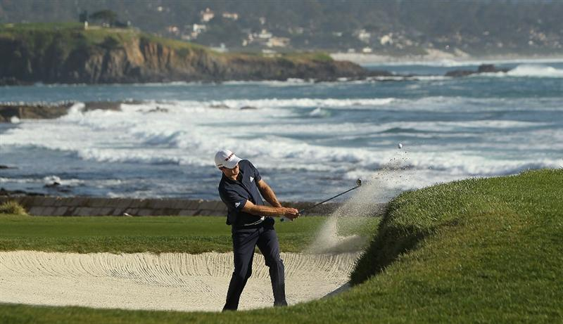 PEBBLE BEACH, CA - FEBRUARY 14:  Dustin Johnson hits out of the bunker on the 18th hole during the final round of the AT&T Pebble Beach National Pro-Am at Pebble Beach Golf Links on February 14, 2010 in Pebble Beach, California.  (Photo by Ezra Shaw/Getty Images)
