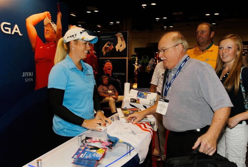 ORLANDO, FL - JANUARY 30:  LPGA player Brittany Lincicome signs autographs for fans at the LPGA booth at the 2010 PGA Merchandise Show at the Orange County Convention Center on January 30, 2010 in Orlando, Florida.  (Photo by Scott Halleran/Getty Images)