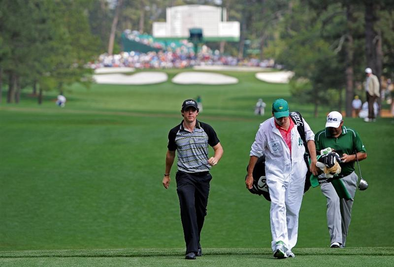 AUGUSTA, GA - APRIL 10:  Rory McIlroy of Northern Ireland (L) walks with his caddie J.P. Fitzgerald (C) and Angel Cabrera of Argentina (R) to the seventh tee during the final round of the 2011 Masters Tournament at Augusta National Golf Club on April 10, 2011 in Augusta, Georgia.  (Photo by Harry How/Getty Images)