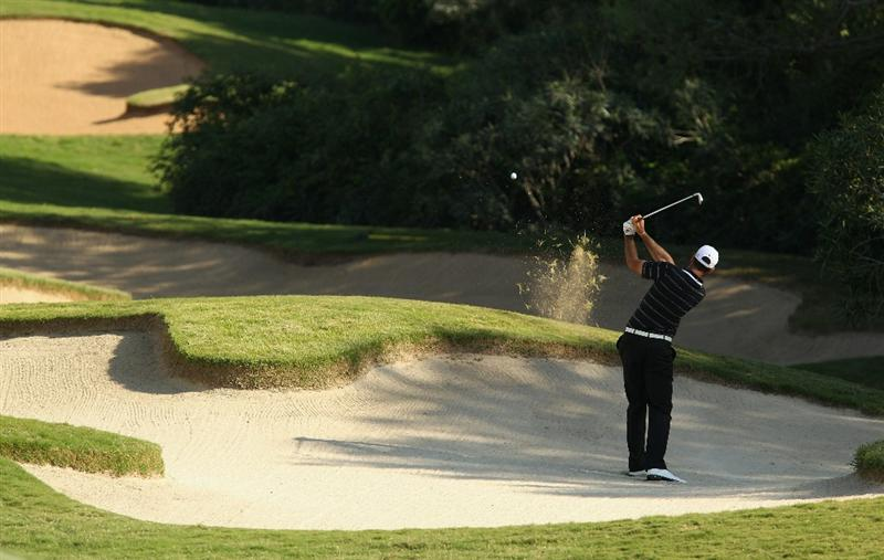 SOTOGRANDE, SPAIN - OCTOBER 29:  Alvaro Quiros of Spain hits the lip of the bunker while playing his approach to the 11th green during the second round of the Andalucia Valderrama Masters at Club de Golf Valderrama on October 29, 2010 in Sotogrande, Spain.  (Photo by Richard Heathcote/Getty Images)