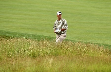 OAKMONT, PA - JUNE 14:  Chris DiMarco checks the yardage on a shot from the rough during the first round of the 107th U.S. Open Championship at Oakmont Country Club on June 14, 2007 in Oakmont, Pennsylvania.  (Photo by David Cannon/Getty Images)