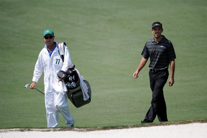 AUGUSTA, GA - APRIL 10:  Charl Schwartzel of South Africa walks with his caddie Greg Hearmon during the final round of the 2011 Masters Tournament at Augusta National Golf Club on April 10, 2011 in Augusta, Georgia.  (Photo by Harry How/Getty Images)