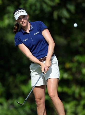 SINGAPORE - MARCH 06:  Brittany Lang of the USA plays a chip shot during the second round of HSBC Women's Champions at the Tanah Merah Country Club on March 6, 2009 in Singapore.  (Photo by Ross Kinnaird/Getty Images)