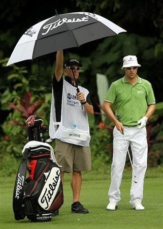 KUALA LUMPUR, MALAYSIA - OCTOBER 29: Ben Crane of USA and his caddie waits on the 1st hole during day two of the CIMB Asia Pacific Classic at The MINES Resort & Golf Club on October 29, 2010 in Kuala Lumpur, Malaysia.  (Photo by Stanley Chou/Getty Images)