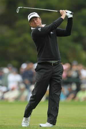 PEBBLE BEACH, CA - JUNE 20:  Tim Clark hits his second shot on the first hole during the final round of the 110th U.S. Open at Pebble Beach Golf Links on June 20, 2010 in Pebble Beach, California.  (Photo by Jeff Gross/Getty Images)
