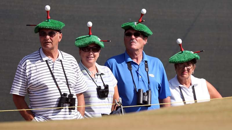 Spectators dressed with golf tees on their heads