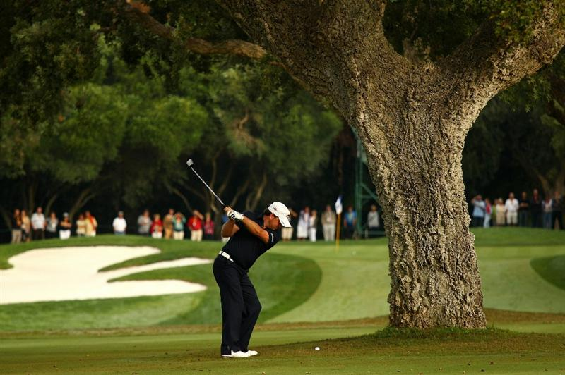 SOTOGRANDE, SPAIN - OCTOBER 28:  Graeme McDowell of Northern Ireland plays into the 2nd green during the first round of the Andalucia Valderrama Masters at Club de Golf Valderrama on October 28, 2010 in Sotogrande, Spain.  (Photo by Richard Heathcote/Getty Images)