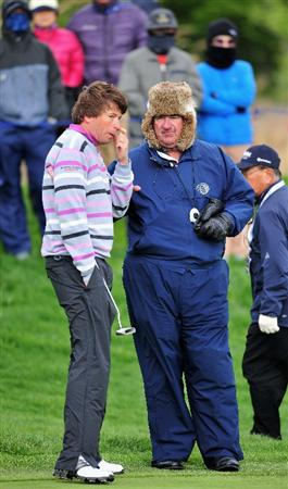JEJU, SOUTH KOREA - APRIL 25:  Robert - Jan Derksen of The Netherlands converses with Chief Rules referee John Paramour about his putt on the 11th hole during the third round of the Ballantine's Championship at Pinx Golf Club on April 25, 2009 in Jeju, South Korea.  (Photo by Stuart Franklin/Getty Images)