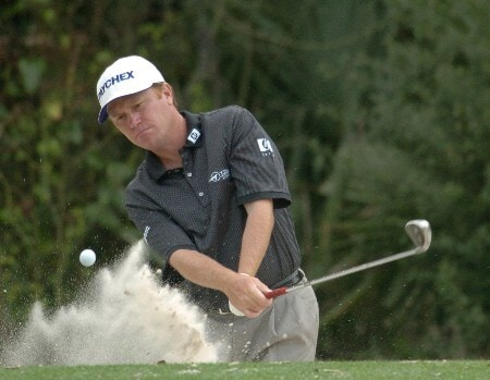 Jeff Sluman blasts from a bunker during a practice round at The Players Championship held at The TPC Sawgrass on Monday, March 21, 2005.