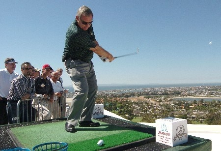 Fuzzy Zoeller follows through on his shot from the 16th floor of The Champions' Tour 2005 Toshiba Classic's 'Closet To The Pin' from the 16th floor at the Newport Beach Marriott Hotel in Newport Beach, California March 15, 2005.