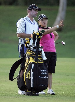 KAPOLEI, HI - FEBRUARY 22:  Jeong Jang of South Korea and her caddie line up a shot on the 5th hole during the second round of the Fields Open on February 22, 2008  at the Ko Olina Golf Club in Kapolei, Hawaii.  (Photo by Andy Lyons/Getty Images)