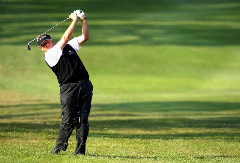 HONG KONG, CHINA - NOVEMBER 20:  Colin Montgomerie of Scotland plays his approach shot on the 15th hole during the first round of the UBS Hong Kong Open at the Hong Kong Golf Club on November 20, 2008 in Fanling, Hong Kong.  (Photo by Stuart Franklin/Getty Images)