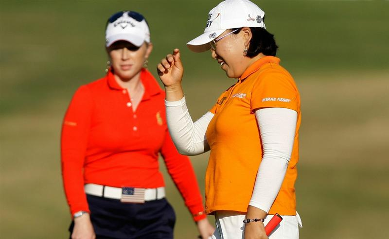 SHIMA, JAPAN - NOVEMBER 06:  Ji-Yai Shin of South Korea gestures as Morgan Pressel of United States watches on the 16th hole during round two of the Mizuno Classic at Kintetsu Kashikojima Country Club on November 6, 2010 in Shima, Japan.  (Photo by Chung Sung-Jun/Getty Images)