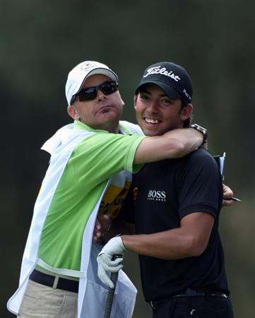 GIRONA, SPAIN - APRIL 30:  Pablo Larrazabal of Spain is hugged by his caddie Rod Gutry on the ninth tee box during the first round of the Open de Espana at the PGA Golf Catalunya on April 30, 2009 in Girona, Spain.  (Photo by Warren Little/Getty Images)
