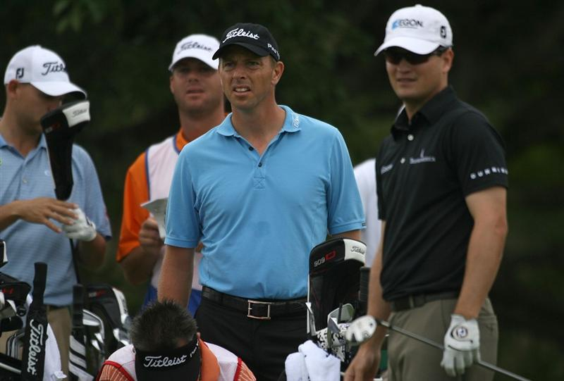 DORAL, FL - MARCH 12:  Soren Hansen of Denmark and Zach Johnson wait to tee off on the fifth tee box during round two of the 2010 WGC-CA Championship at the TPC Blue Monster at Doral on March 12, 2010 in Doral, Florida.  (Photo by Marc Serota/Getty Images)