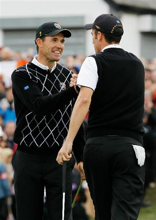 NEWPORT, WALES - OCTOBER 02:  Ross Fisher (R) and Padraig Harrington of Europe celebrate during the rescheduled Afternoon Foursome Matches during the 2010 Ryder Cup at the Celtic Manor Resort on October 2, 2010 in Newport, Wales.  (Photo by Sam Greenwood/Getty Images)