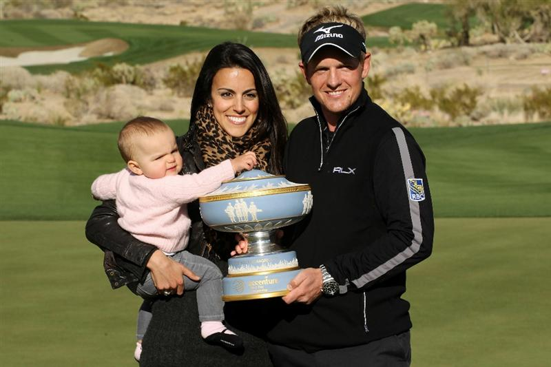 MARANA, AZ - FEBRUARY 27:  Luke Donald of England (R), his wife Diane (C) and daughter Elle (L) celebrate with The Walter Hagen Cup trophy after winning his match 3-up on the 16th hole during the final round of the Accenture Match Play Championship at the Ritz-Carlton Golf Club on February 27, 2011 in Marana, Arizona.  (Photo by Andy Lyons/Getty Images)