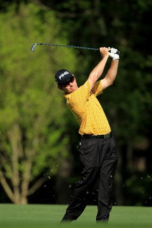 AUGUSTA, GA - APRIL 07:  Louis Oosthuizen of South Africa hits his second shot on the 11th hole during the first round of the 2011 Masters Tournament at Augusta National Golf Club on April 7, 2011 in Augusta, Georgia.  (Photo by David Cannon/Getty Images)