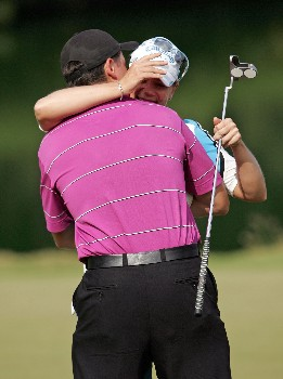 KAHUKU, HI - FEBRUARY 16:  Annika Sorenstam of Sweden hugs Mike McGee after finishing at 10 under par to win the SBS Open on February 16, 2008  at the Turtle Bay Resort in Kahuku, Hawaii.  (Photo by Andy Lyons/Getty Images)