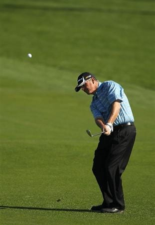 PEBBLE BEACH, CA - FEBRUARY 14:  Paul Goydos plays a shot on the third hole during the final round of the AT&T Pebble Beach National Pro-Am at Pebble Beach Golf Links on February 14, 2010 in Pebble Beach, California.  (Photo by Ezra Shaw/Getty Images)