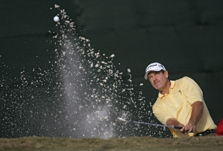 Bart Bryant hitting out of the bunker on the 18th green and making a birdie during the third round of THE TOUR Championship at East Lake Golf Club in Atlanta, Georgia on November 5, 2005. Bryant finished the third round in the lead at -14.Photo by Sam Greenwood/WireImage.com