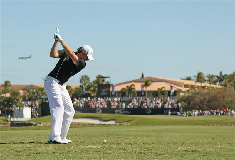 DORAL, FL - MARCH 13:  Rory McIlroy of Northern Ireland hits his tee shot on the ninth hole during the final round of the 2011 WGC- Cadillac Championship at the TPC Blue Monster at the Doral Golf Resort and Spa on March 13, 2011 in Doral, Florida.  (Photo by Mike Ehrmann/Getty Images)