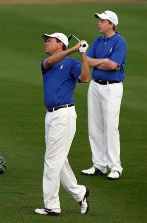 CHAMPIONS GATE, FL - DECEMBER 06:  Davis Love III of the USA is watched by his son Dru Love as he hits his second shot at the 1st hole during the first round of the Del Webb Father Son Challenge on the International Course at Champions Gate Golf Club on December 6, 2008 in Champions Gate, Florida.  (Photo by David Cannon/Getty Images)