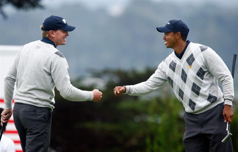 SAN FRANCISCO - OCTOBER 10:  Steve Stricker and Tiger Woods of the USA Team celebrate a birde to win the 12th hole during the Day Three Afternoon Fourball Matches of The Presidents Cup at Harding Park Golf Course on October 10, 2009 in San Francisco, California.  (Photo by Scott Halleran/Getty Images)